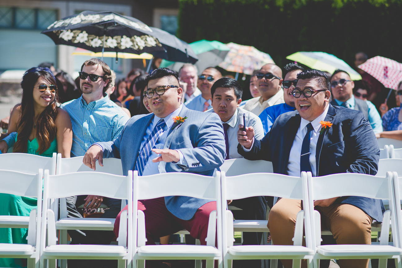 bride's brothers and guests laughing while waiting for wedding ceremony to start