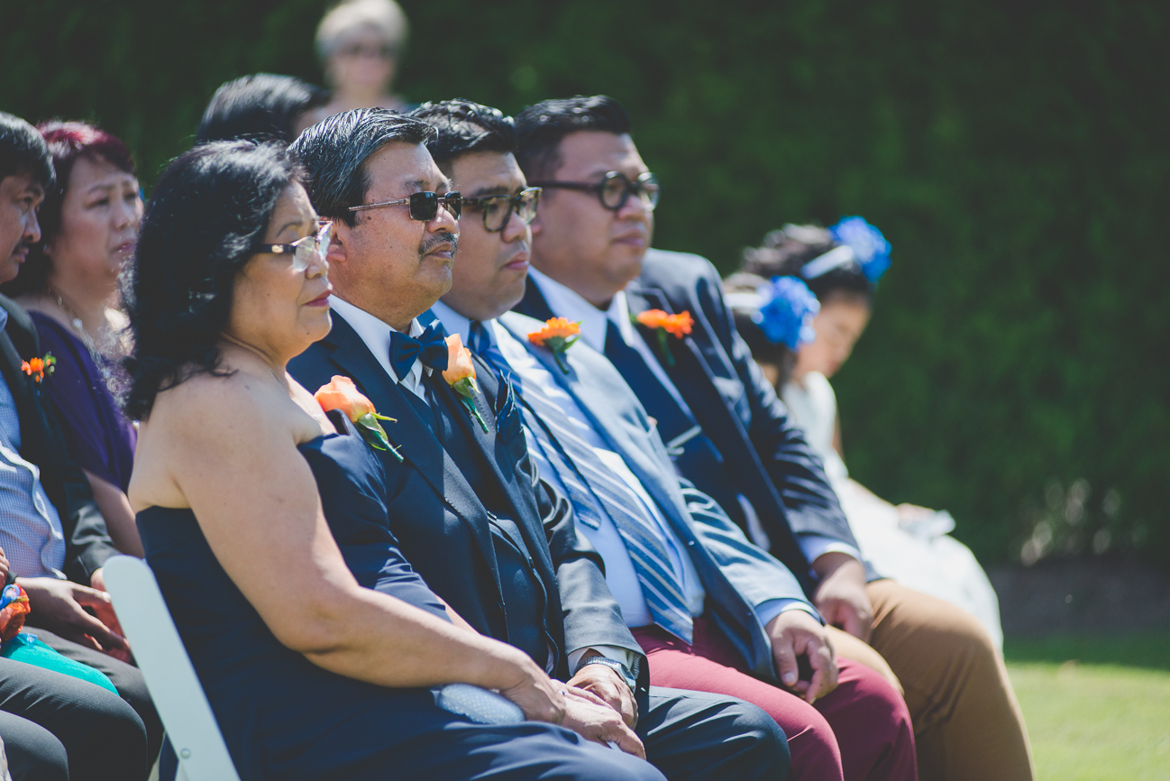bride's parents and brothers watching wedding ceremony from front row