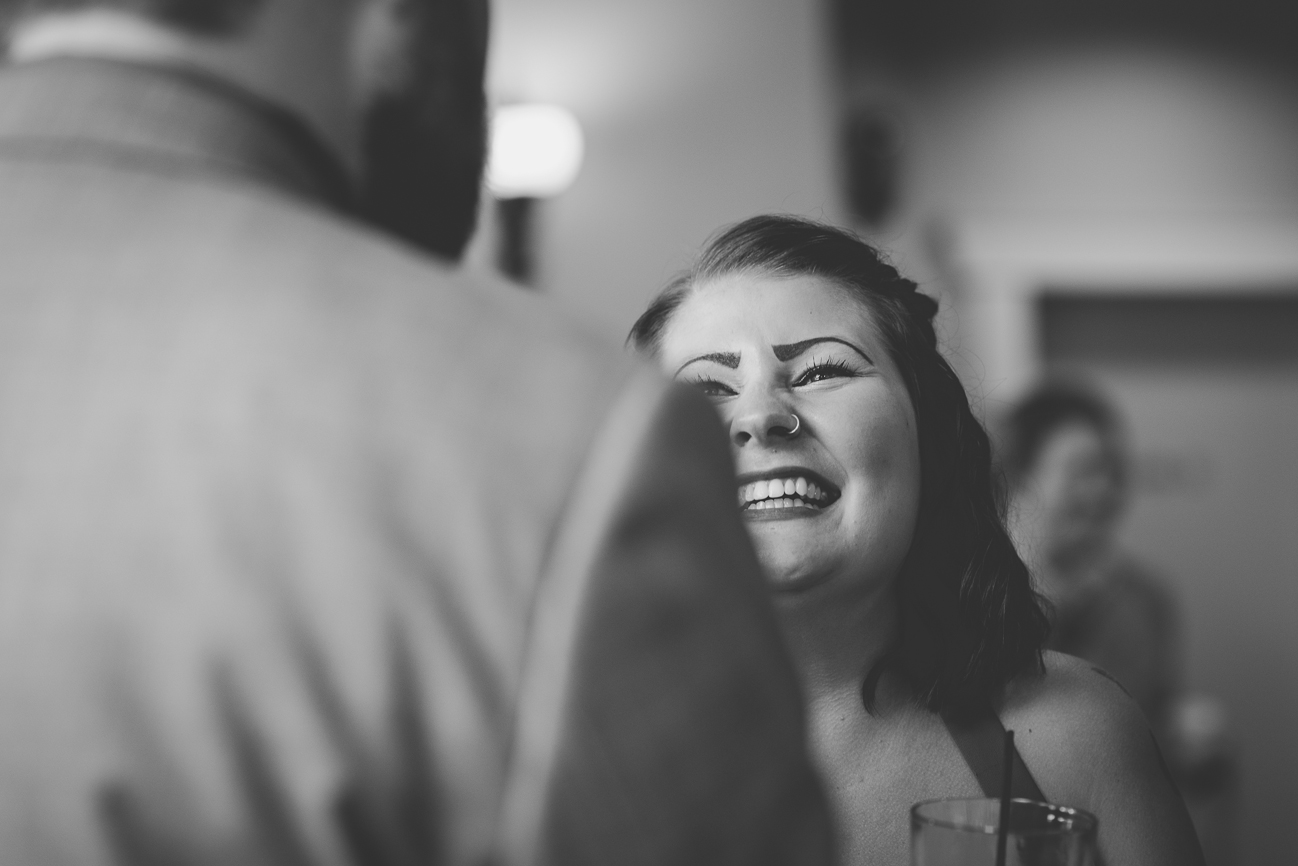 bridesmaid laughing during cocktail hour