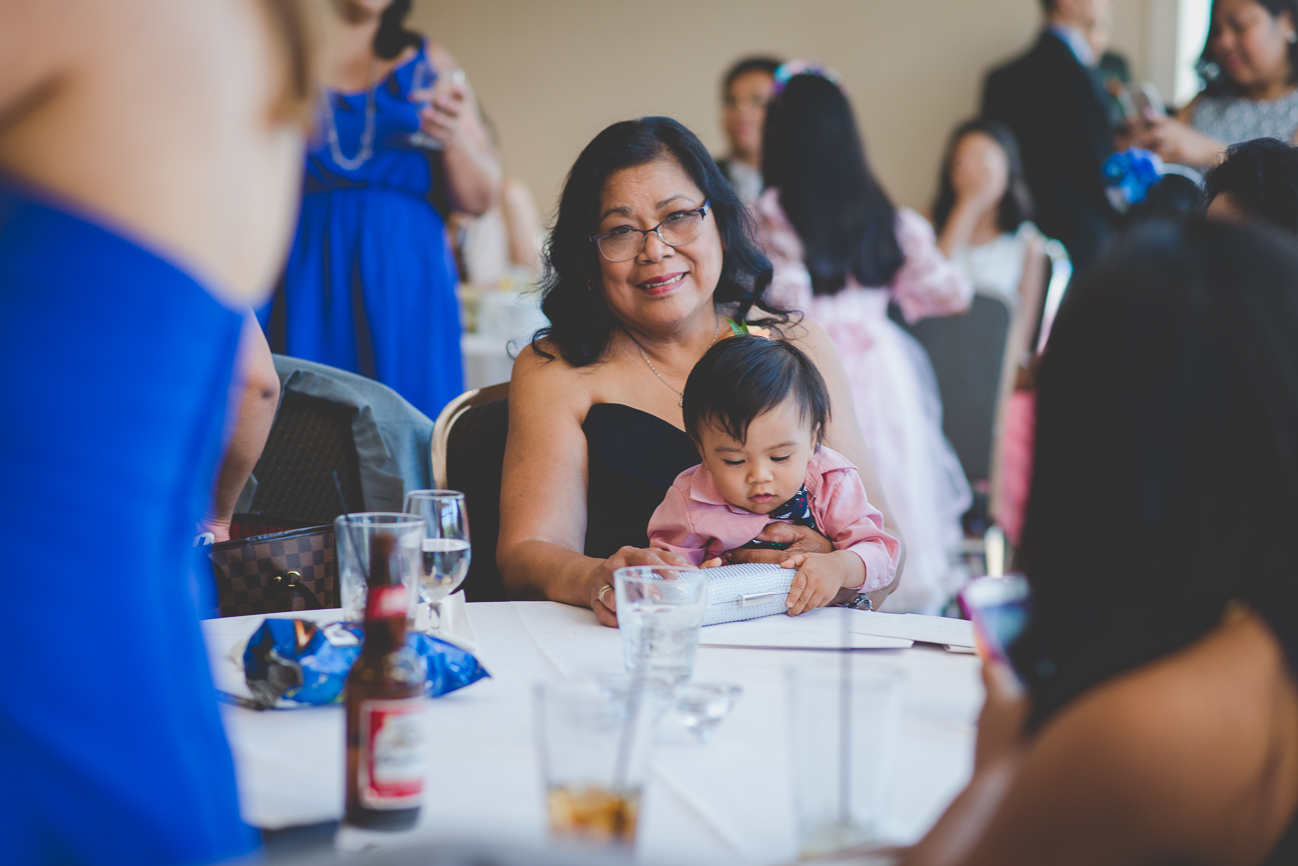 mother of the bride with toddler nephew during cocktail hour at wedding reception