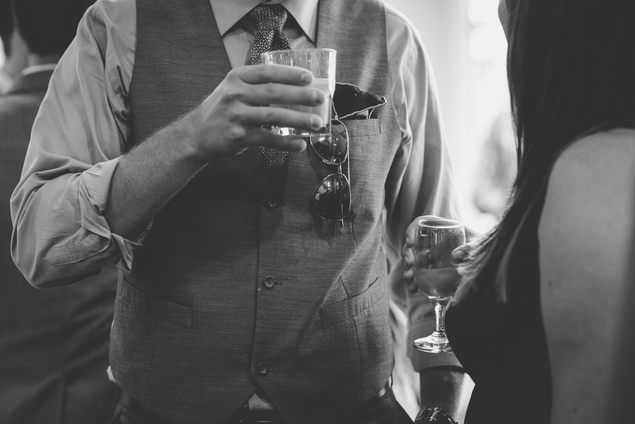 guests drinking during cocktail hour at wedding reception