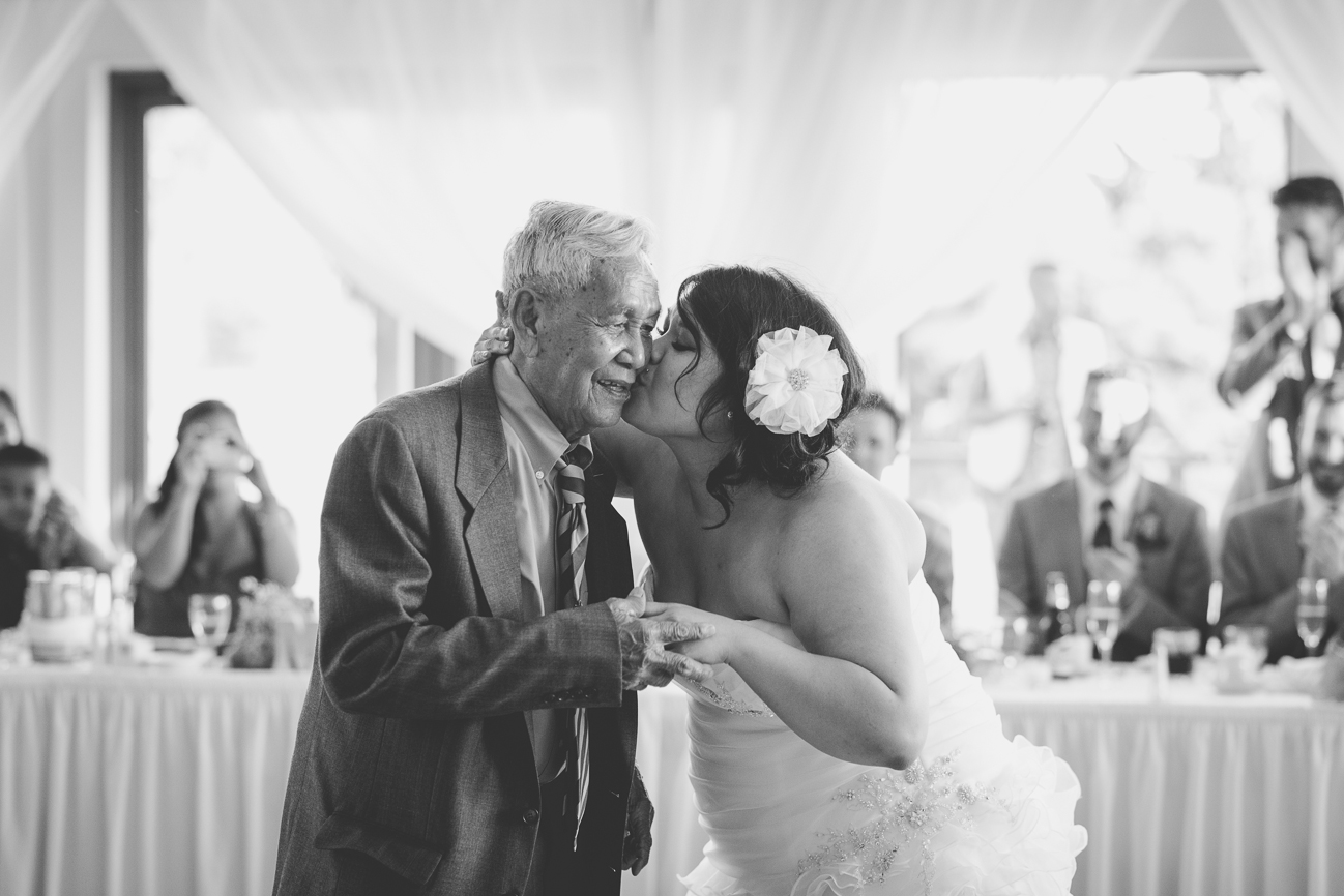 bride kisses 90 year-old grandfather after dancing during father daughter dance at wedding reception