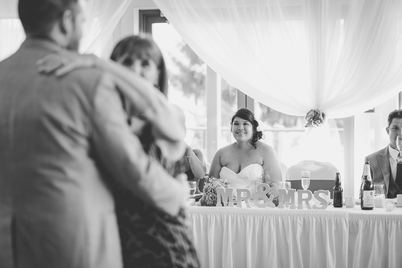 bride watching groom dance with his mother during mother son dance at wedding reception