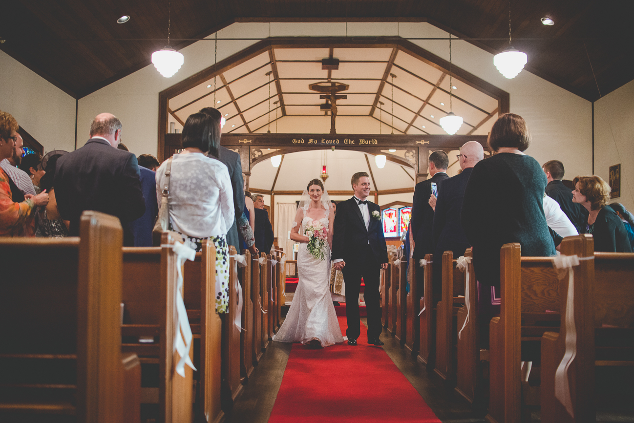 bride and groom walking back down the aisle for first time as husband and wife