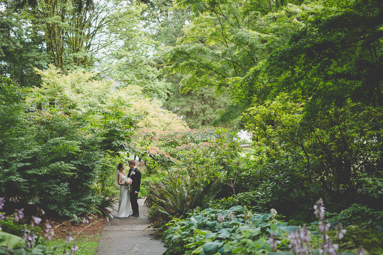 bride and groom sharing a quiet moment in a garden during portrait