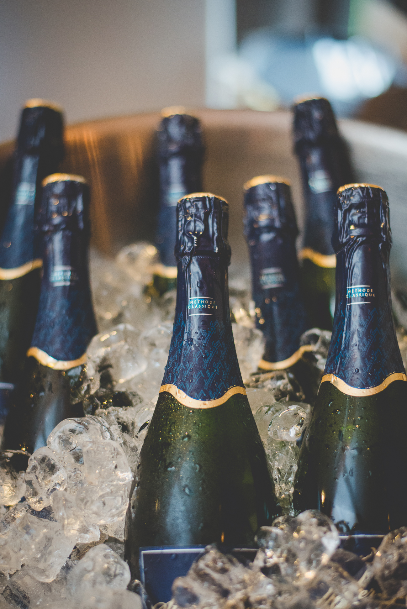 bottles of champagne in ice at wedding reception