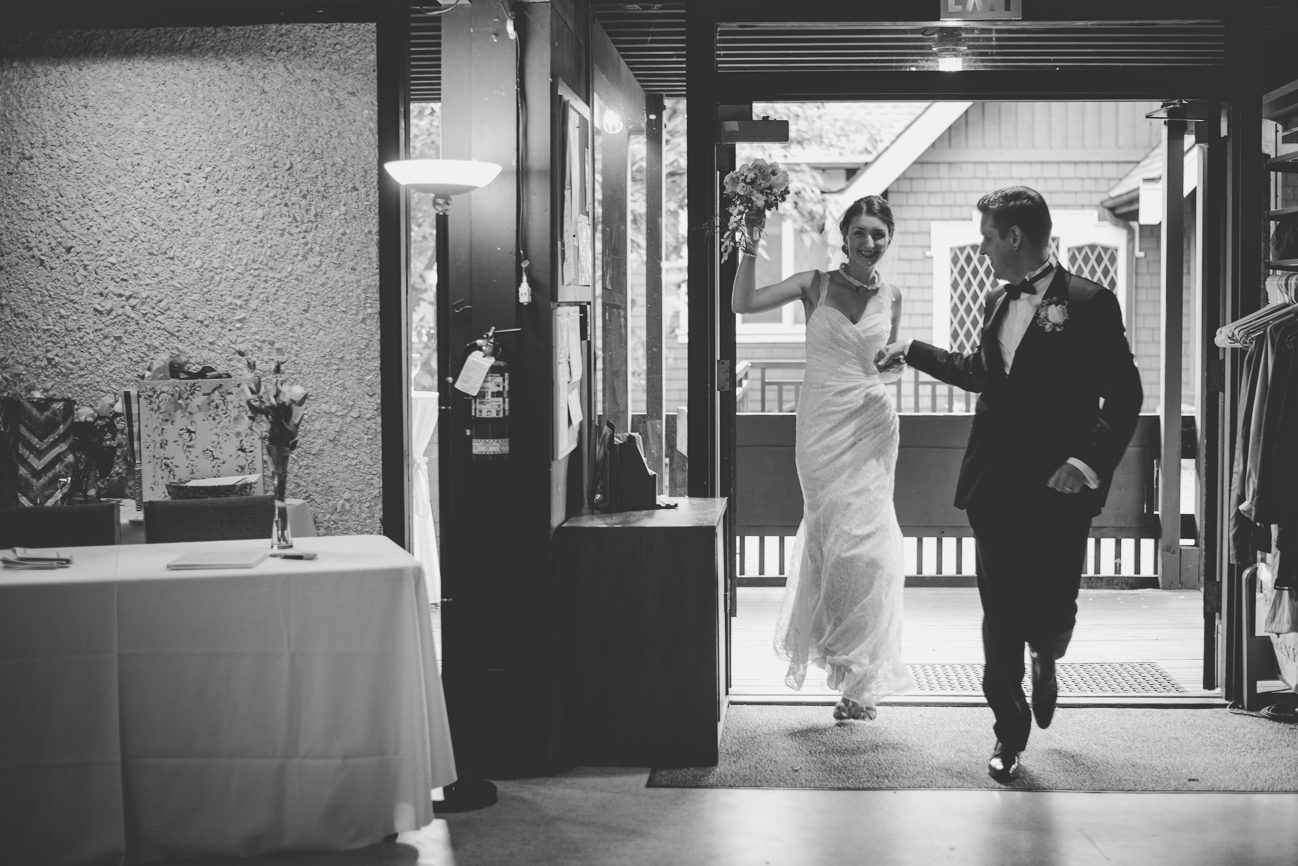 bride and groom dancing into reception after being introduced for grand entrance