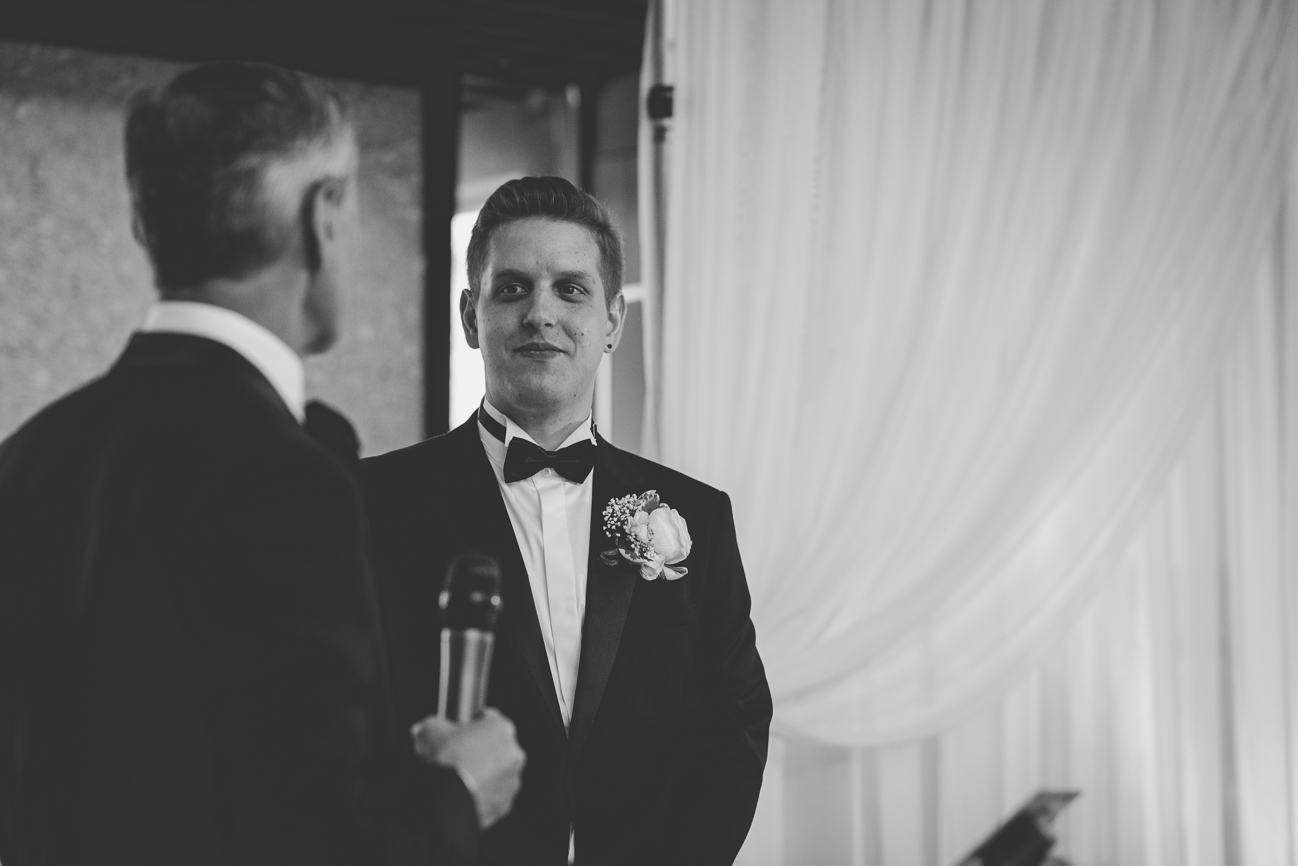 father of the bride giving a speech to his new son-in-law at wedding reception
