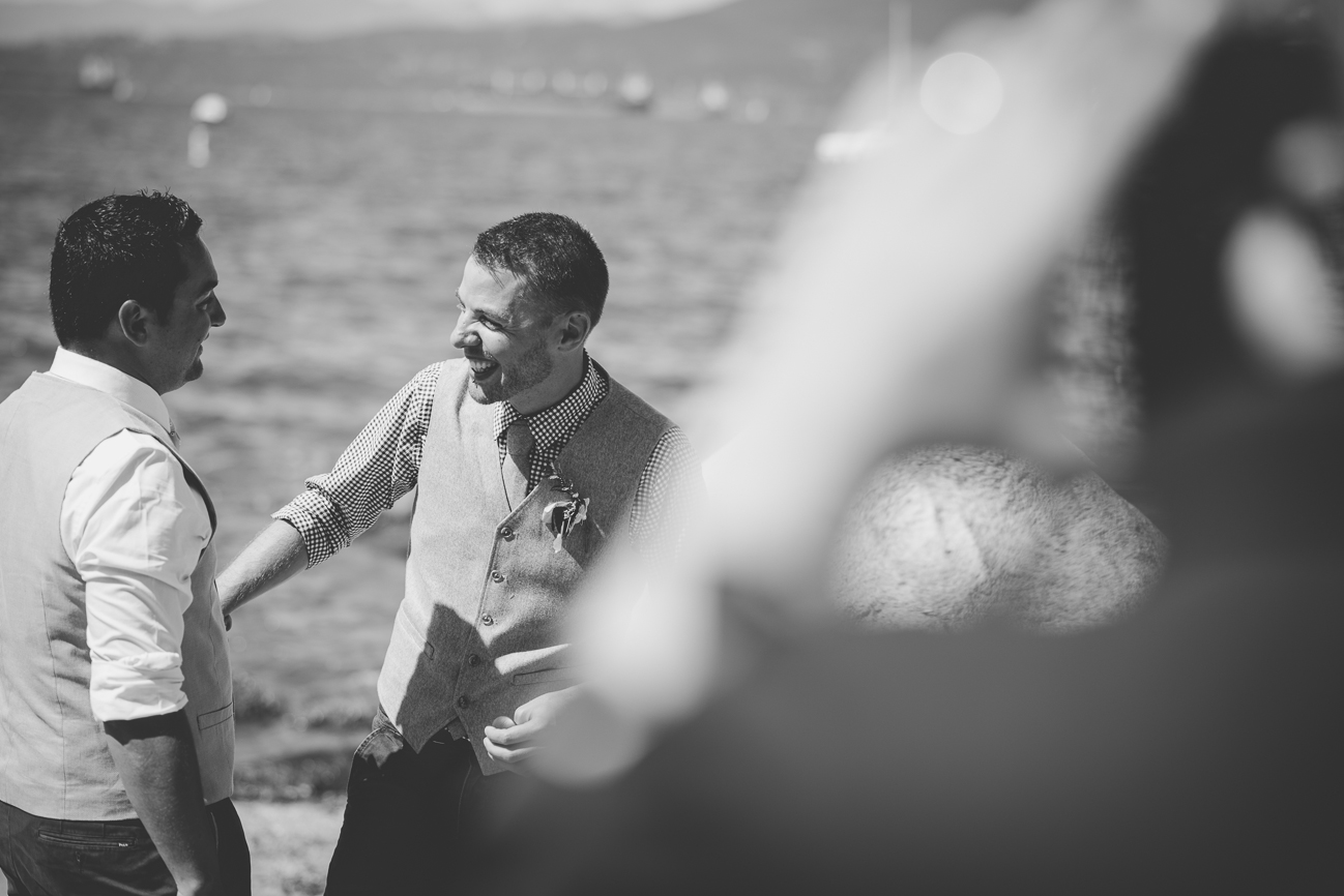 grooms laugh together during same sex elopement in Vancouver, BC