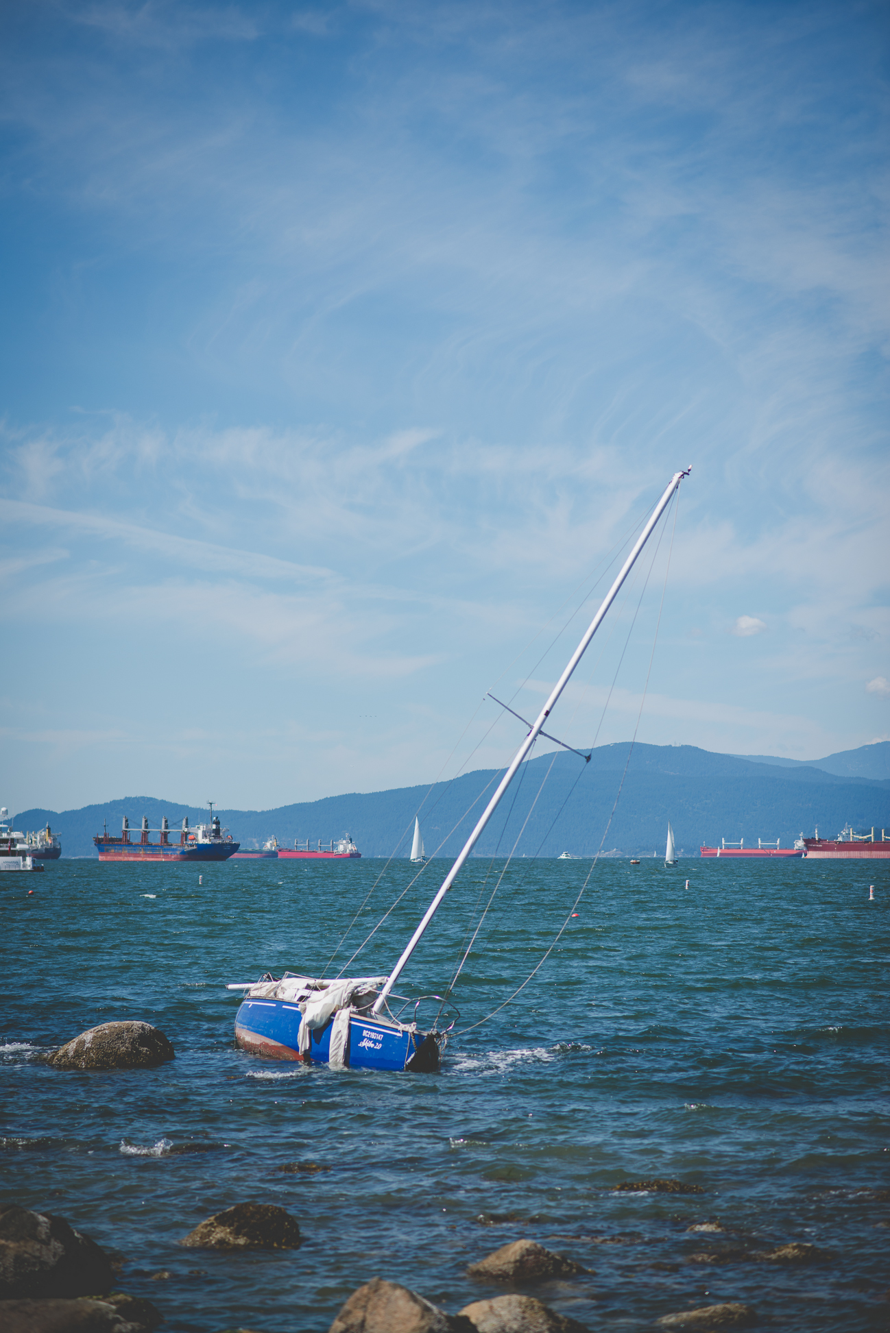 sailboat in water at Kits Beach in Vancouver, BC