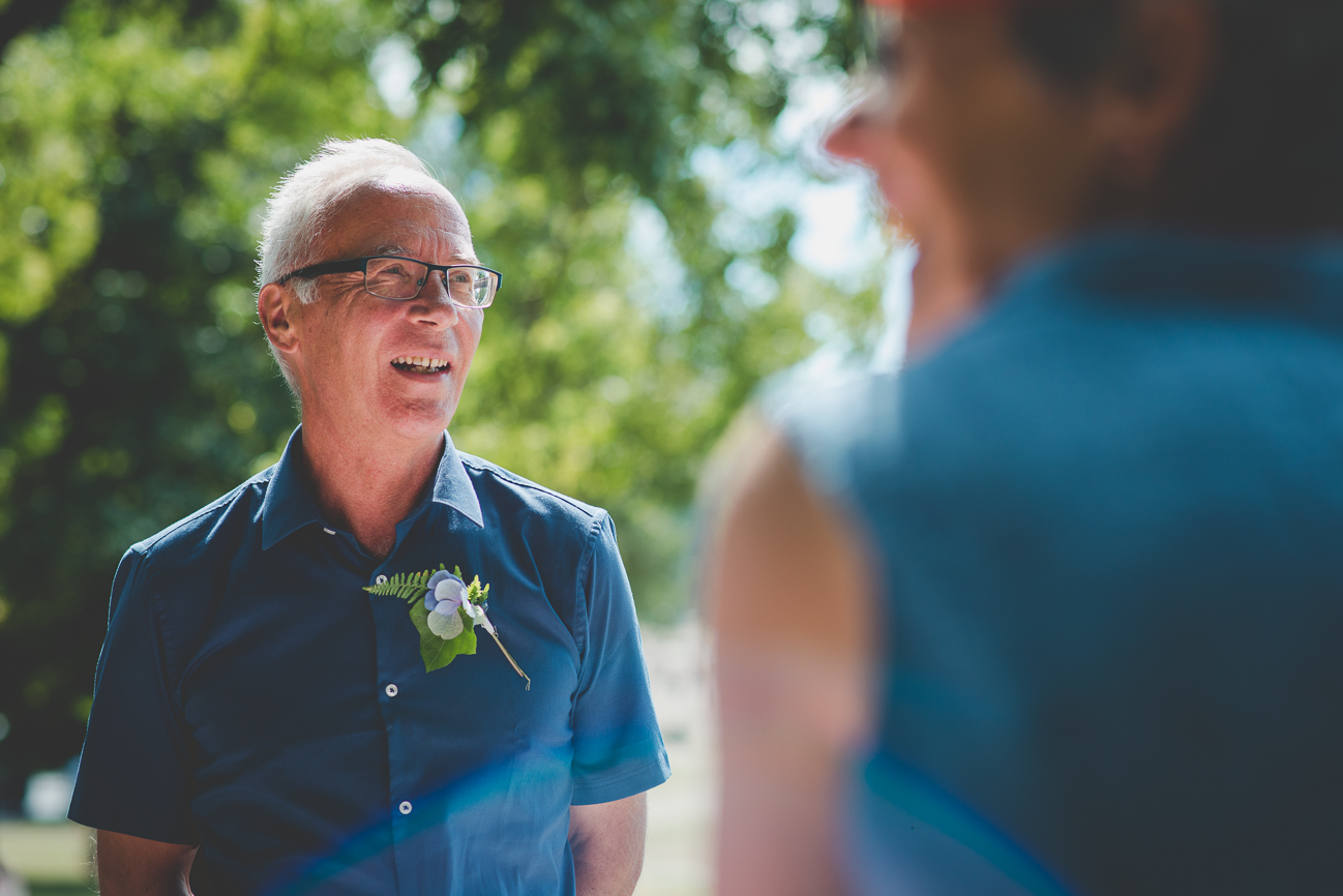 father of the groom smiles during BBQ reception at Kitsilano Beach elopement