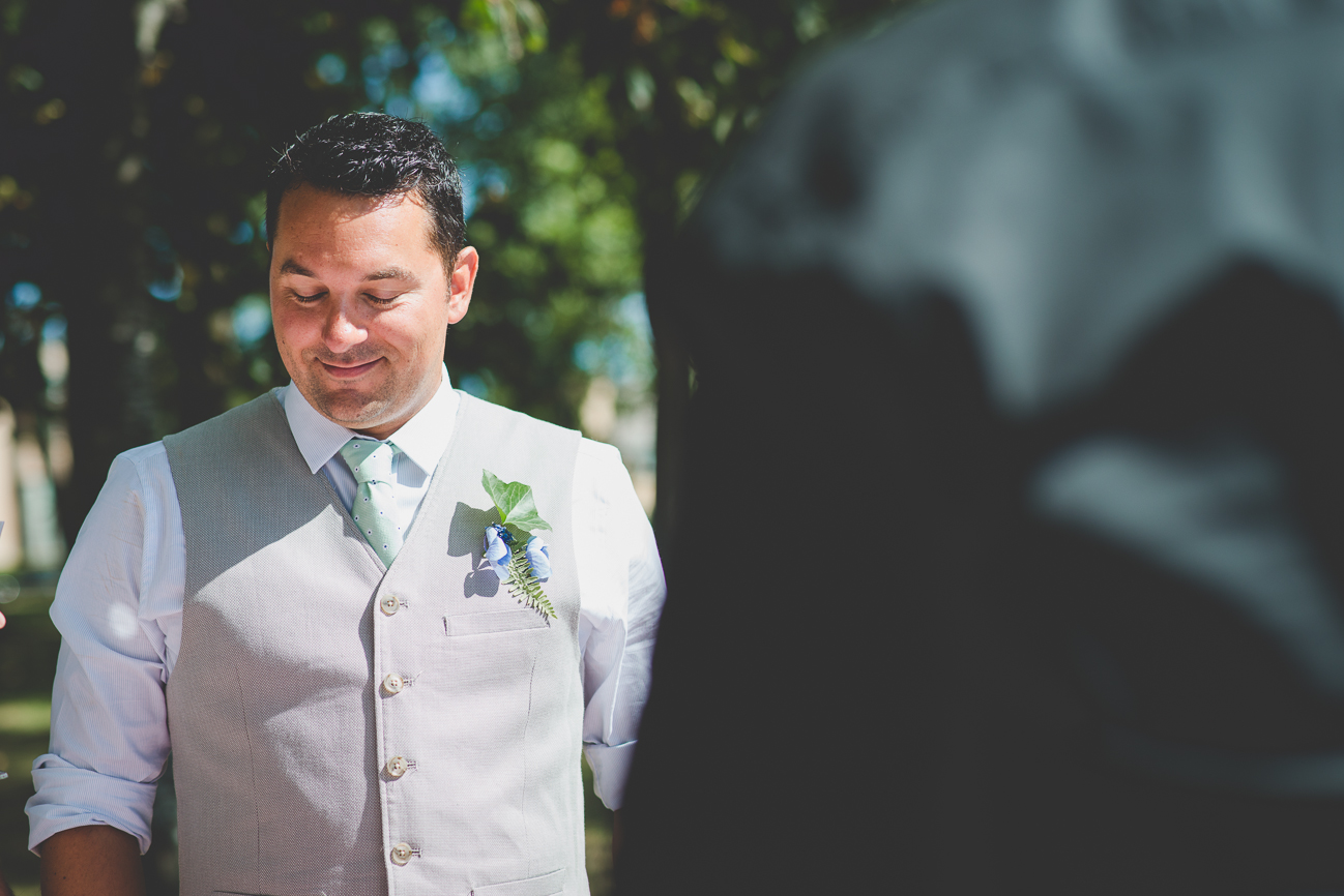 groom smiles and listens to mother's toast during BBQ picnic reception at Kits Beach
