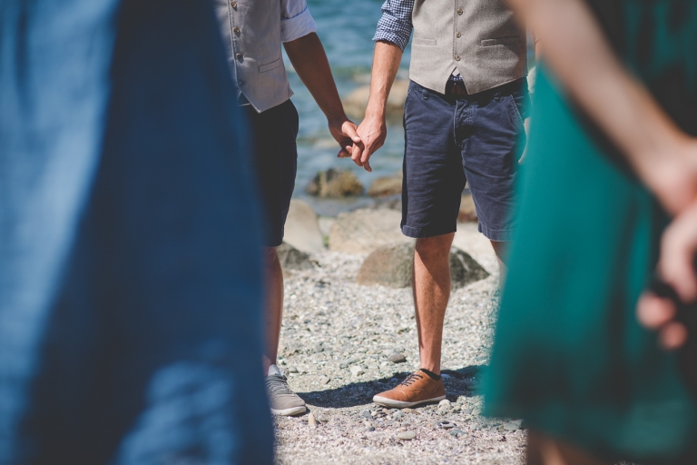 grooms holding hands during intimate Kits Beach elopement
