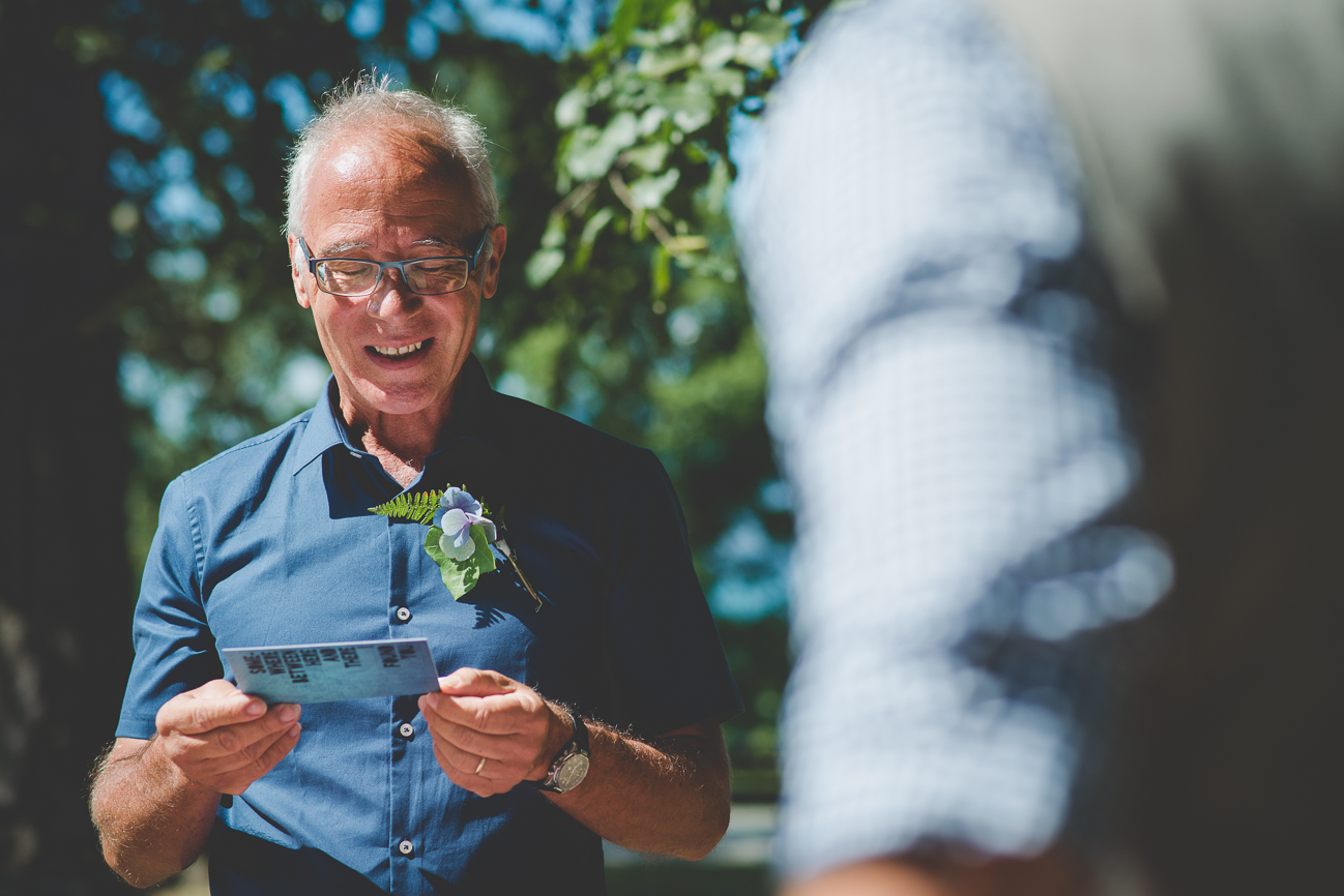 father of the groom makes speech at intimate picnic reception after Kitsilano Beach elopement