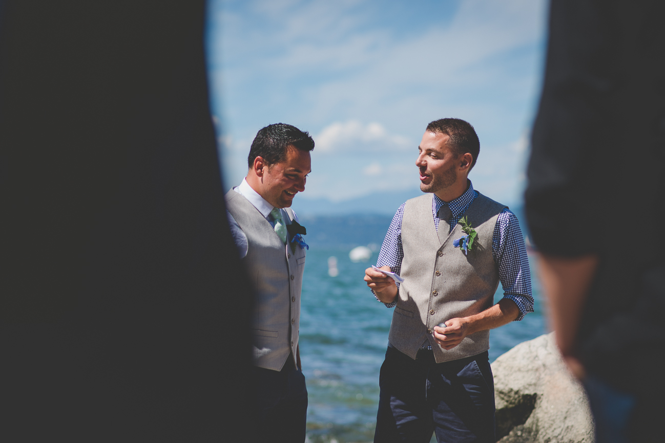 groom sings to partner on beach during same sex elopement in Vancouver, BC