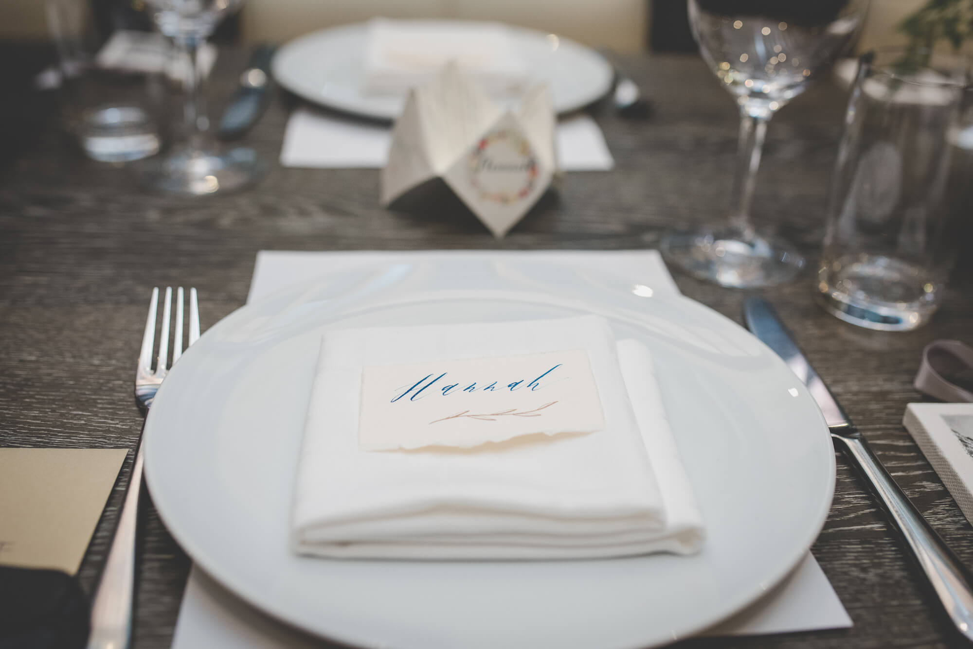 place setting with whimsical rustic calligraphy name card