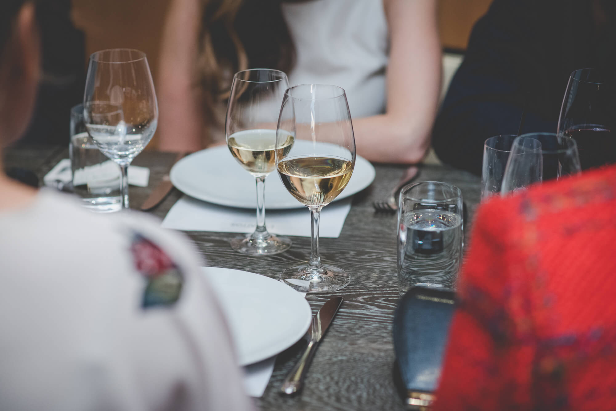 5 reasons to have an open bar wedding | glasses of wine sitting on table at L'Abattoir wedding reception