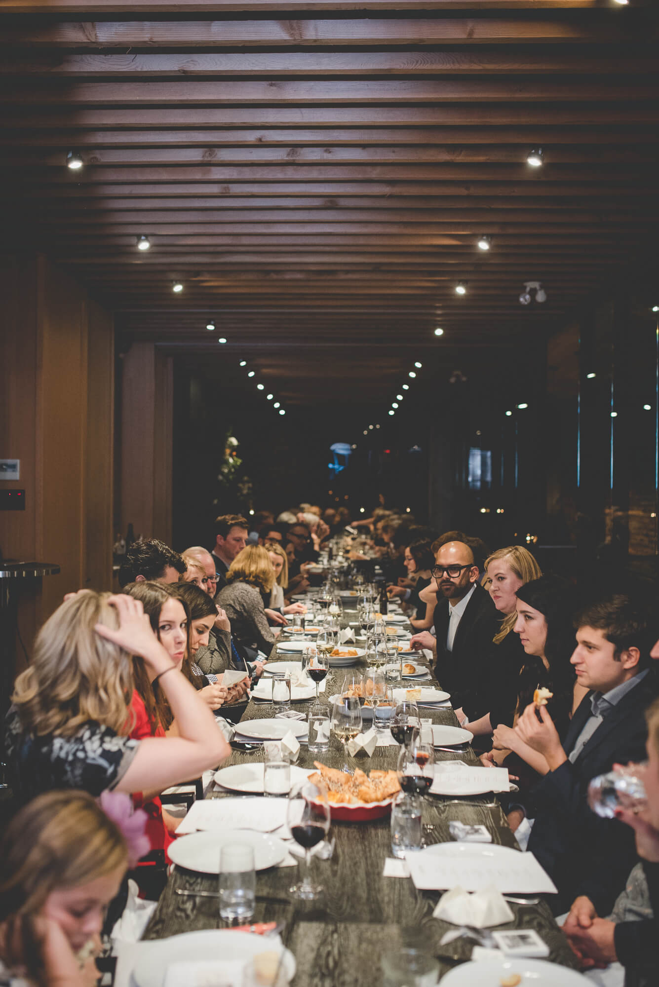 guests seated around a long table for wedding reception at L'Abattoir Restaurant in Gastown
