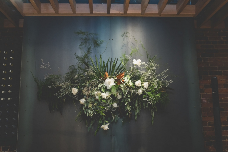 wall floral arrangement at wedding reception at L'Abattoir Restaurant in Vancouver