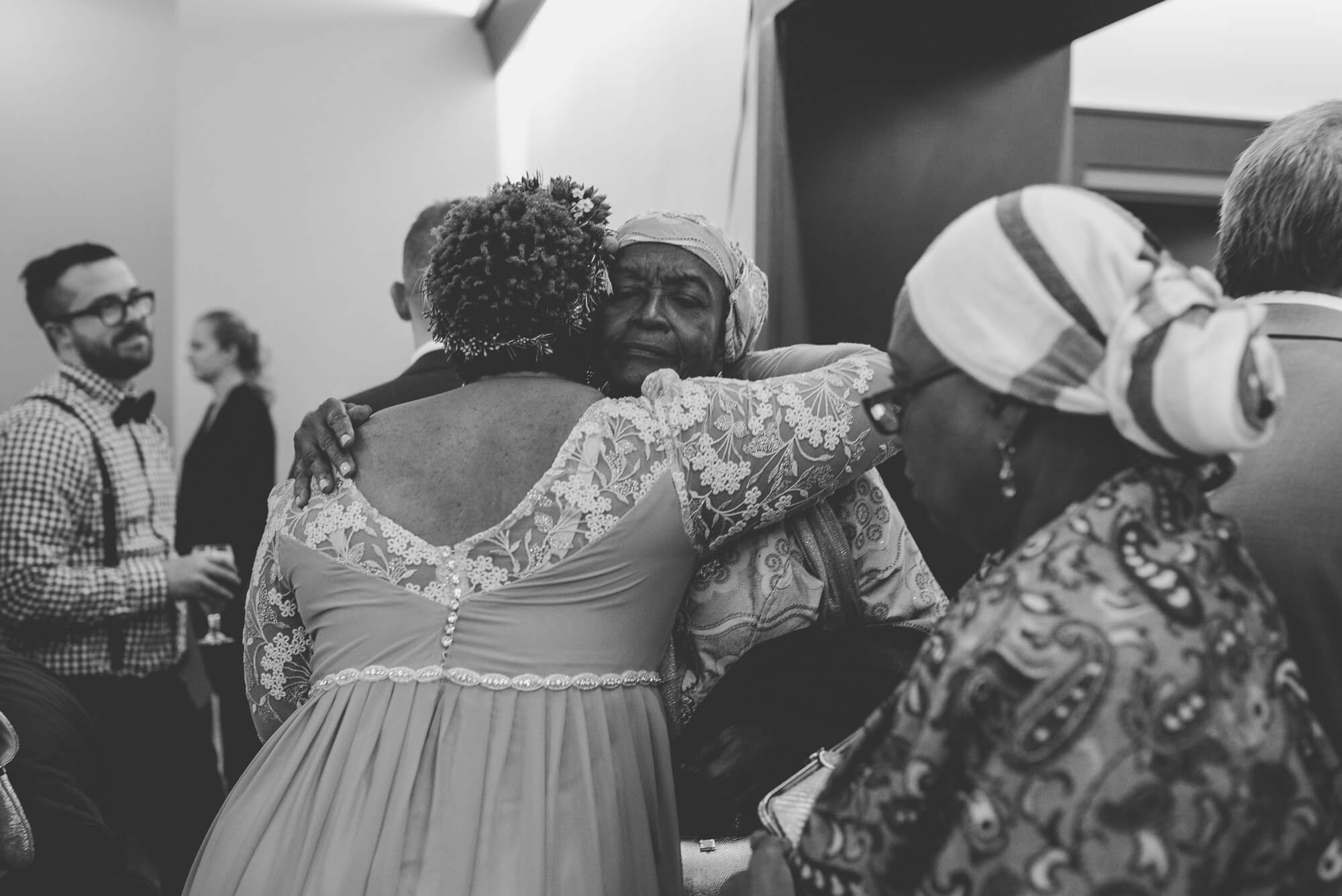 bride hugging family members in receiving line after wedding ceremony at Centennial Lodge