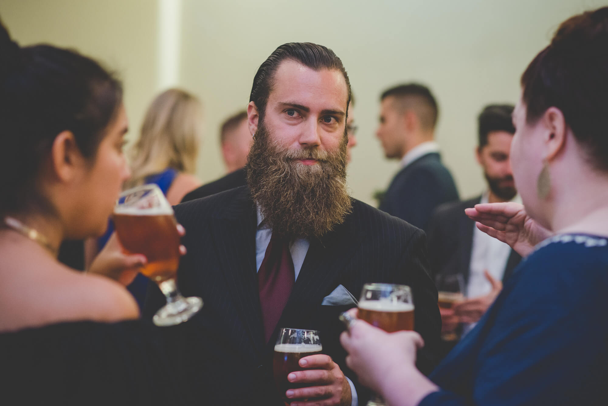 guests drinking Steel & Oak Brewing beers during cocktail hour at Centennial Park wedding reception