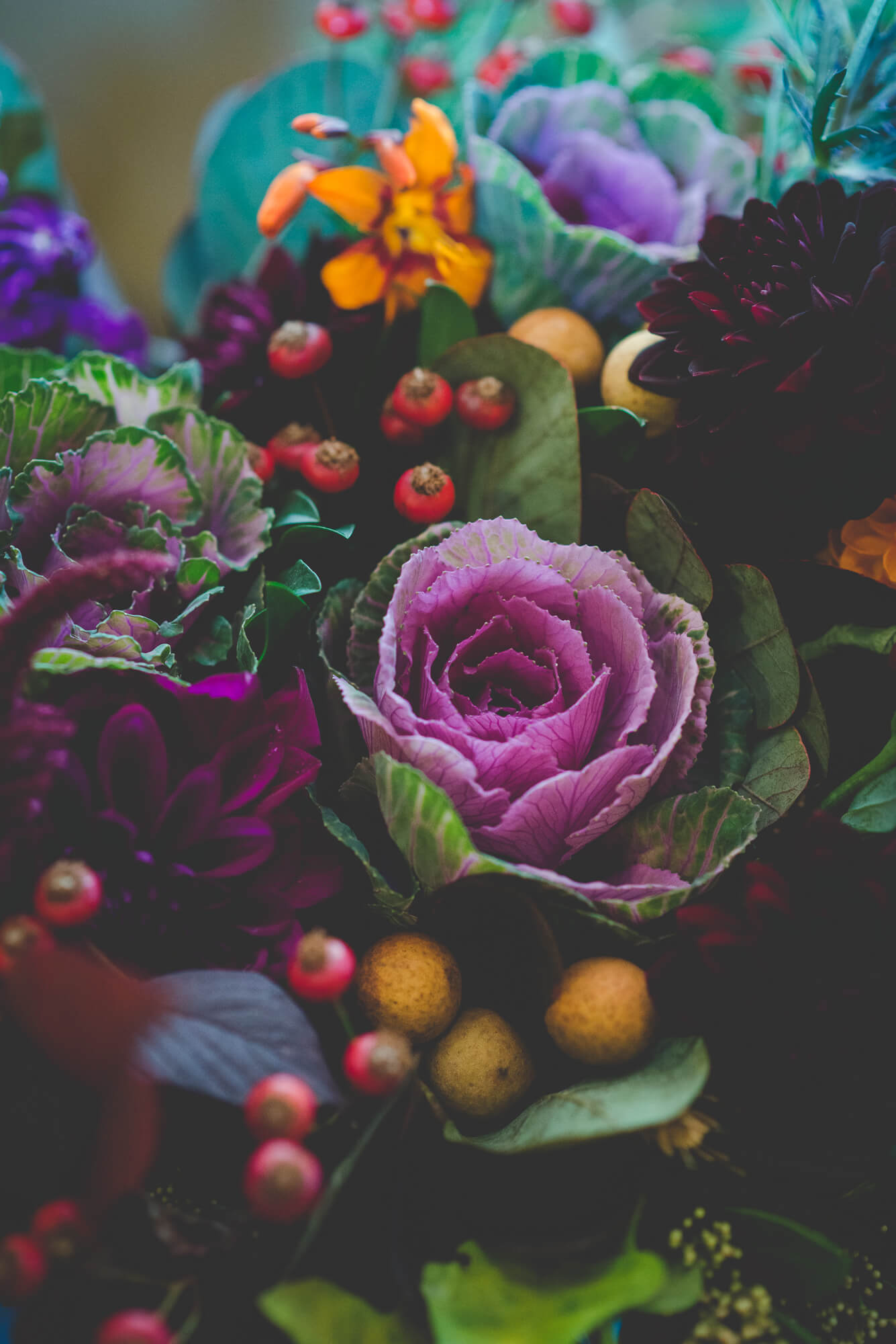 eclectic wedding floral arrangement with flowers, greenery, and succulents