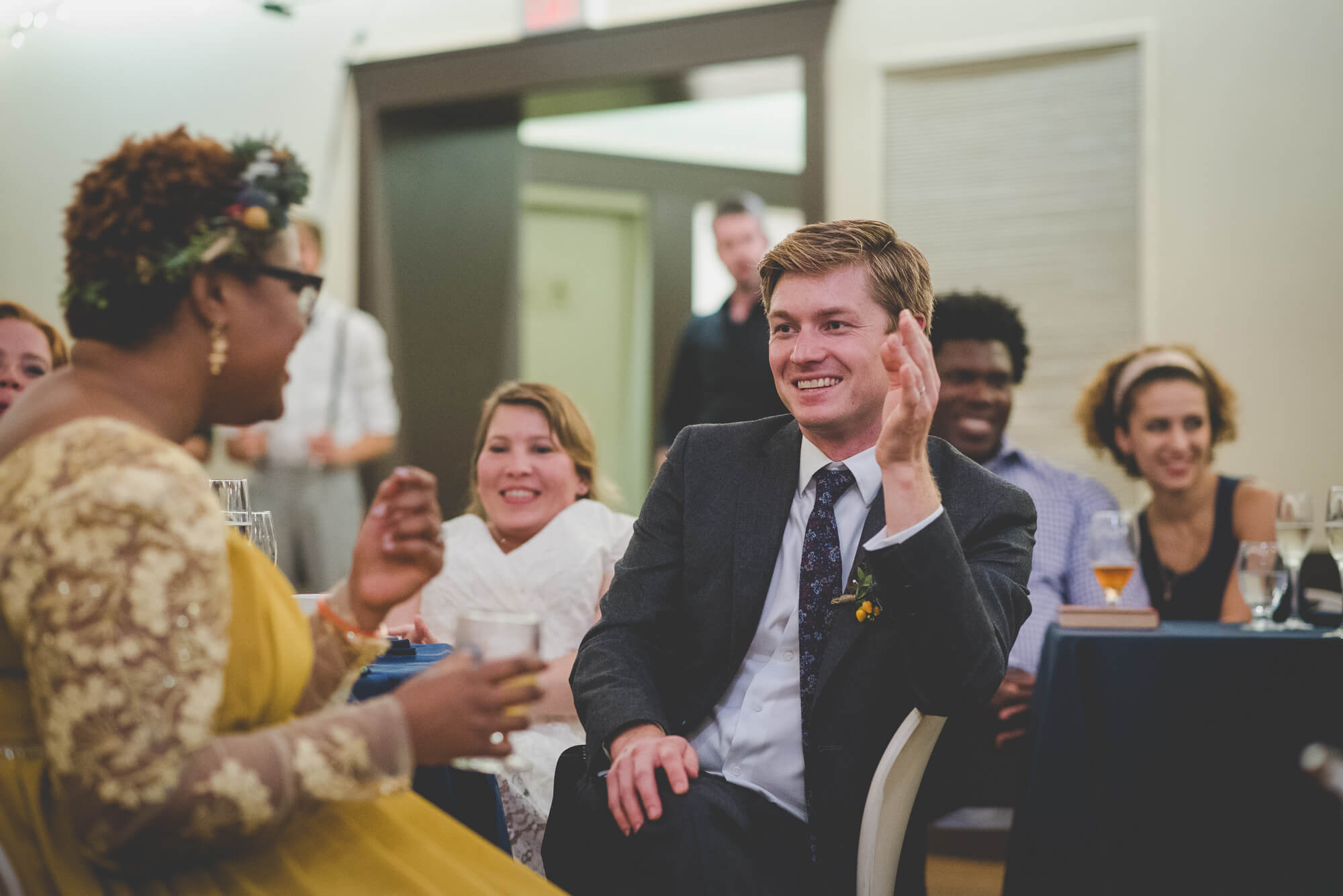 groom laughing during toasts at Centennial Lodge wedding reception