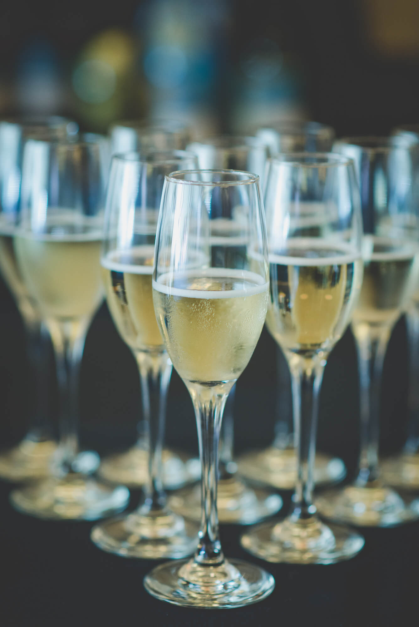 tray of champagne in glasses for toasts at Centennial Lodge wedding reception