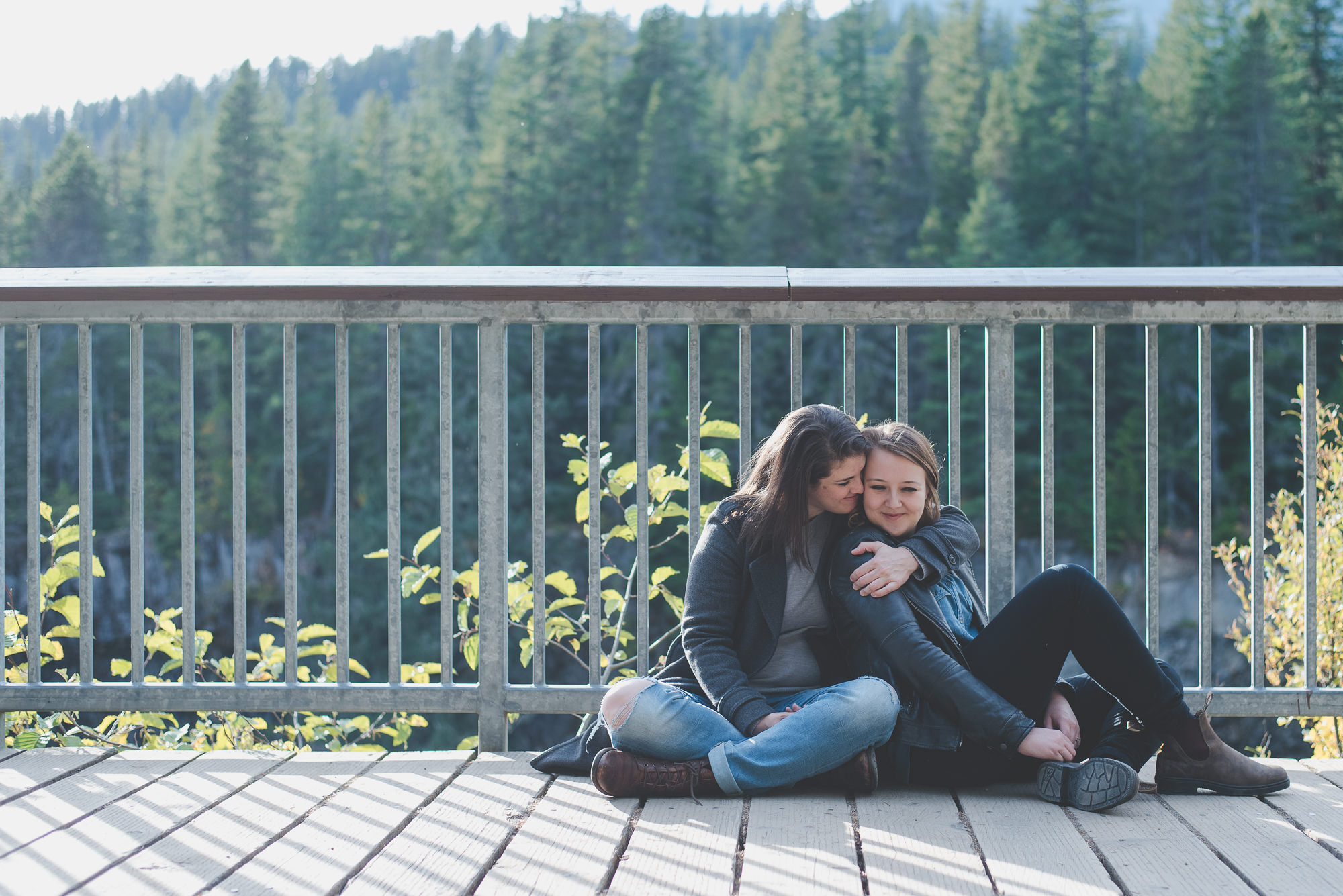 woman wrapping her arms around her girlfriend's shoulders at lookout point