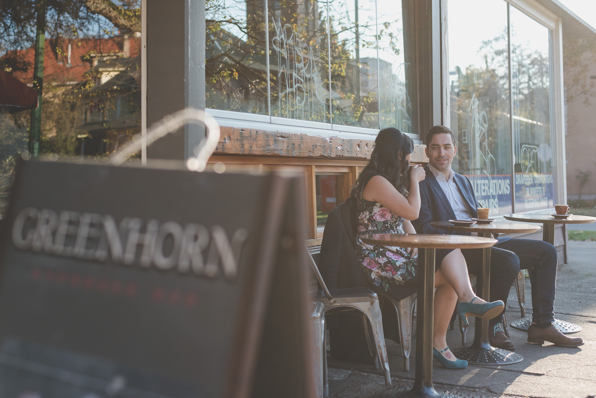 couple drinking coffee outside of Greenhorn Espresso Bar in Vancouver